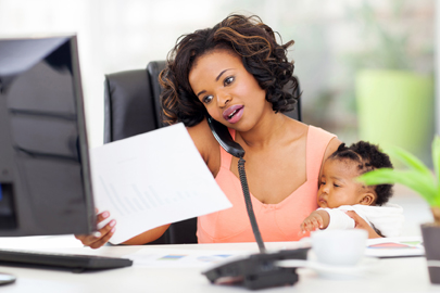 african american woman with baby girl working from home